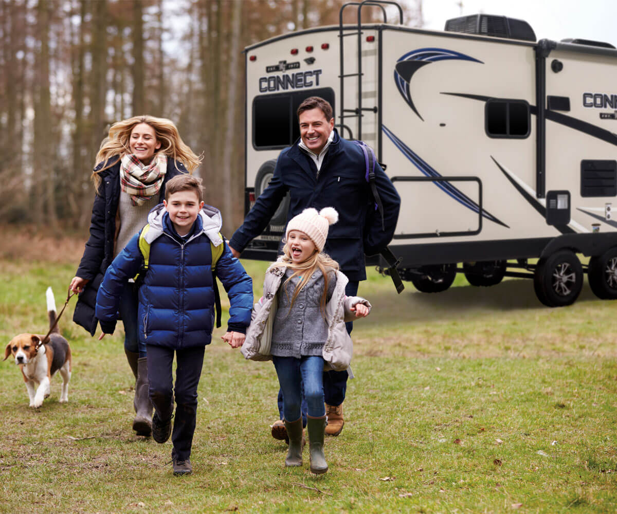 2018 Connect Lightweight Travel Trailer with Family Hiking Outdoors