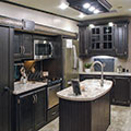 2018 KZ RV Durango D325RLT Fifth Wheel Kitchen in Travertine Decor