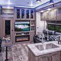 2018 KZ RV Venom V3911TK Fifth Wheel Toy Hauler Living Room with Accent Lights On