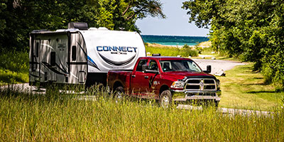 2020 KZ RV Connect C261RKK Travel Trailer being towed down road