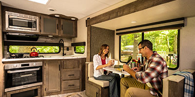 2020 KZ RV Connect C261RKK Travel Trailer with Couple at Dinette