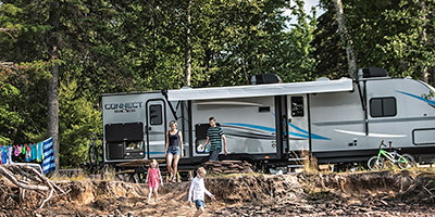 2020 KZ RV Connect C332BHK Travel Trailer with family at campsite