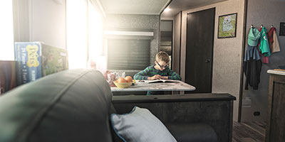 2020 KZ RV Connect C332BHK Travel Trailer with boy at dinette