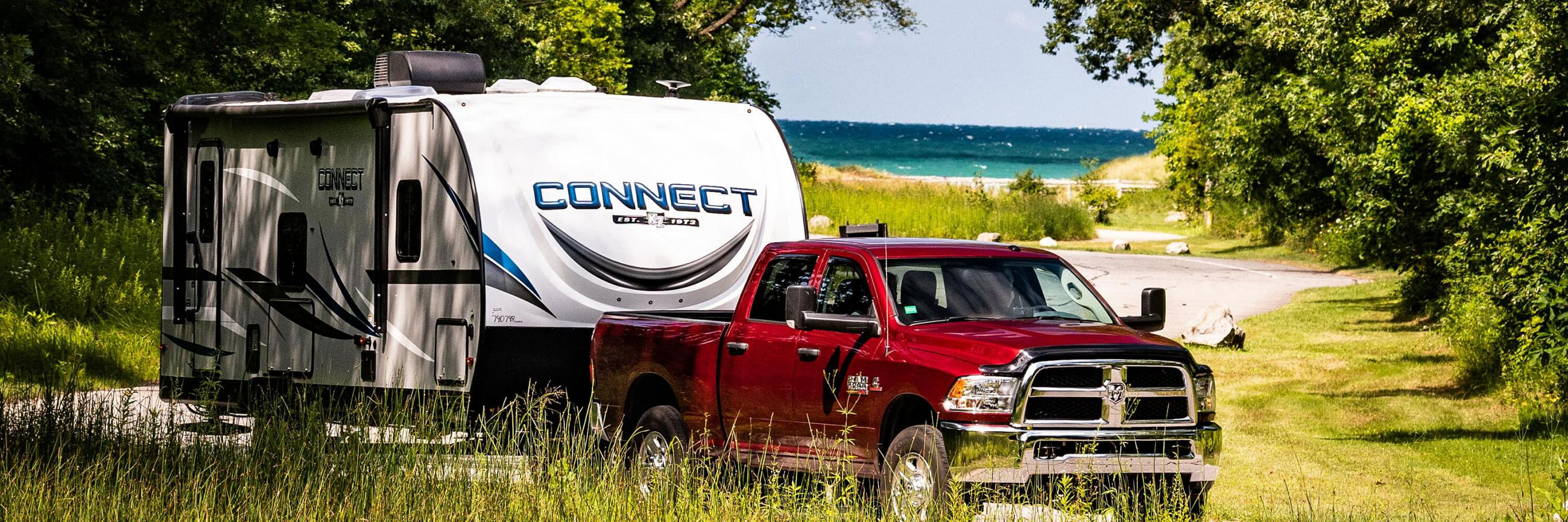 2020 KZ RV Connect Travel Trailer being Towed to Campsite